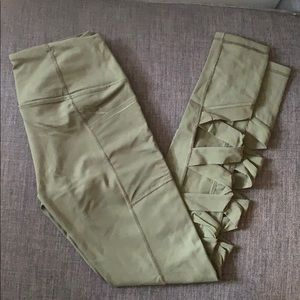Army green leggings worth cool cutouts and pockets